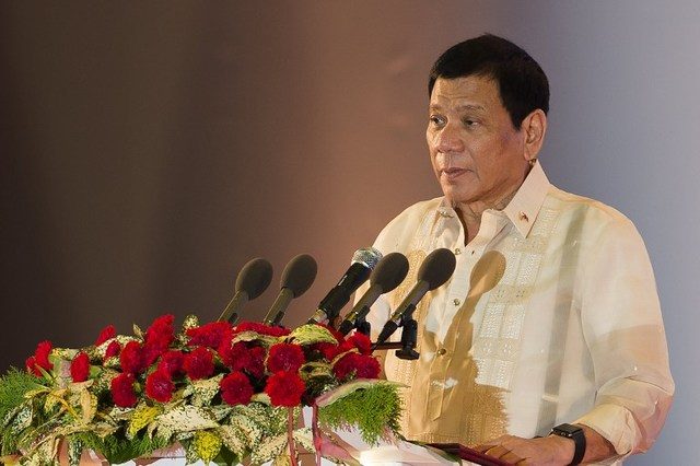 Philippine President Rodrigo Duterte speaks during the closing ceremony of the Association of Southeast Asian Nations (ASEAN) and handover of the ASEAN chairmanship to the Philippines in Vientiane on September 8, 2016. ASEAN leaders gather in Vientiane for the 28th and 29th ASEAN Summits held between September 6 to 8. / AFP PHOTO / YE AUNG THU