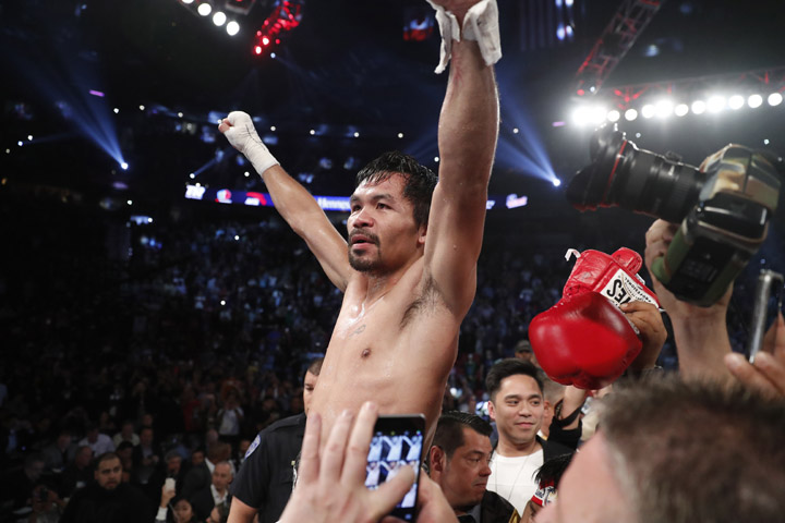 Manny Pacquiao, of the Philippines, celebrates after defeating Jessie Vargas in their WBO welterweight title boxing match, Saturday, Nov. 5, 2016, in Las Vegas. (AP Photo/Isaac Brekken)