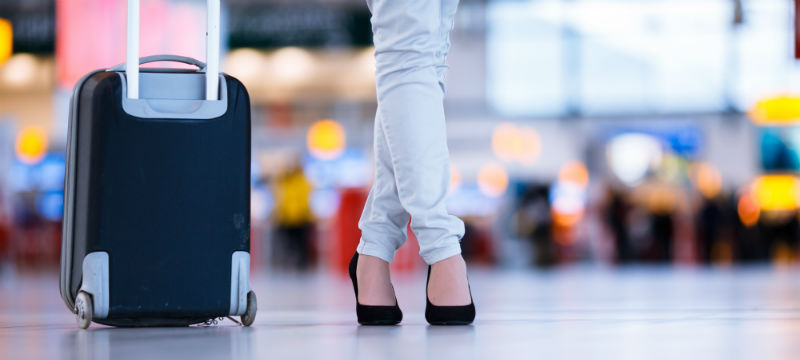 Woman-Suitcase-Airport-800x360