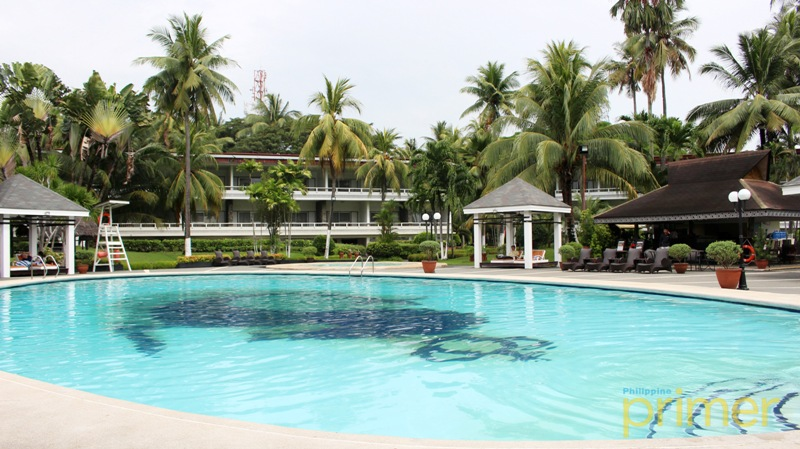 Bask In The Sun And Take A Dip On Their Wide Pool Waterfront Insular Hotel